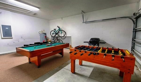 Garage has a air-hockey table, pool table and foosball table