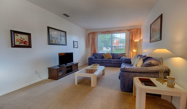 Spacious living room with comfortable furniture and 50 inch flat-screen TV