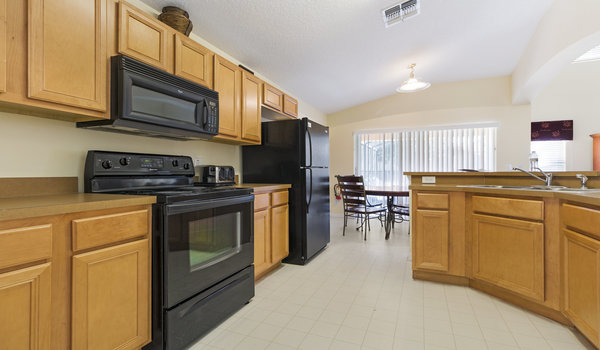 Kitchen has an open view to the spacious family room