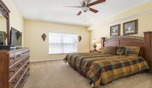 First floor master bedroom with a king size bed