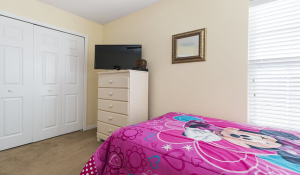 This bedroom has two twin beds and closet space