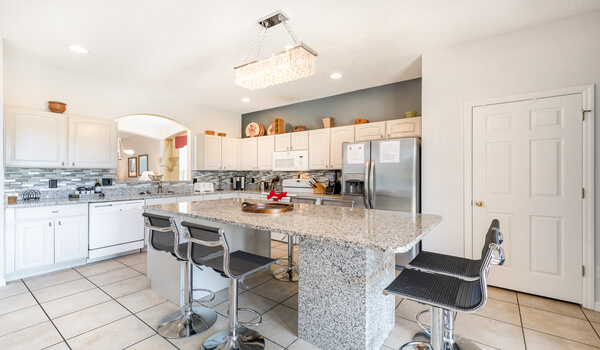 Kitchen with huge sit-in granite dining area