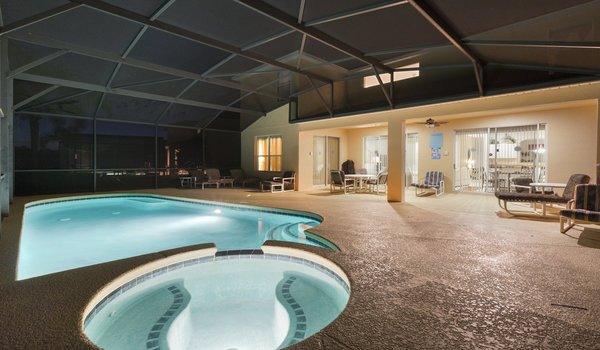 Night view of pool and spa
