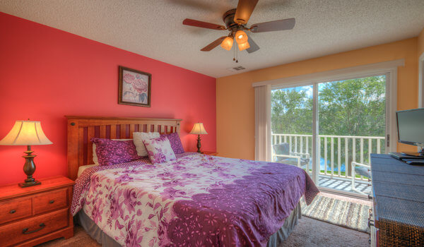 Master suite with queen bed and attached bathroom