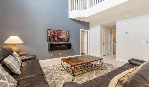 Family room offers comfortable leather seating