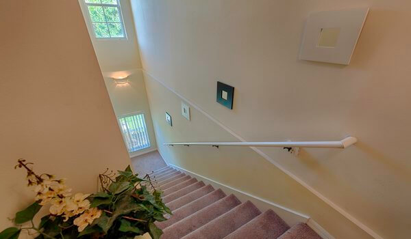 Stairs to the bedrooms and bathrooms